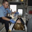 Stock Photo: Paramedic With Victim In Ambulance