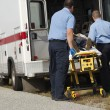 Paramedics With Victim On Stretcher - Foto Stock