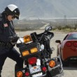 Traffic Cop Writing Against Motorcycle — Stock Photo