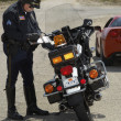 Traffic Cop Writing Against Motorcycle — Stock Photo #21958615