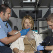 Paramedics Taking Care Of Victim In Ambulance — Stock fotografie