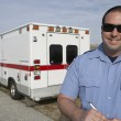Stock Photo: Paramedic In Front Of Ambulance