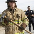 Stock Photo: Firefighter With Police Officer