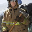 Female Firefighter Holding Axe — Stock Photo #21958963