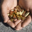 Man's Hands Holding Bullets — Stock Photo