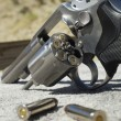 Stockfoto: Bullets Beside Gun