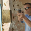 Stock Photo: MAiming Hand Gun At Firing Range