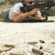 Bullets On Ground With Man Aiming Machine Gun — Foto de Stock
