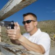 Stock Photo: MAiming Machine Gun At Firing Range