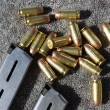 Foto de Stock  : Gun Magazine And Bullets On Carpet