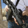 Stock Photo: WomHolding Machine Gun At Firing Range