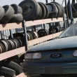 Tires And Car At Scrap Yard — Stock Photo