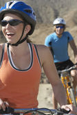 Young Couple Cycling In Mountains — Stock Photo