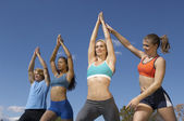 Group Exercising With Instructor In Park — Stock Photo