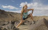 Woman Stretching On Rock — Stock Photo