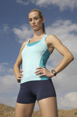Female Jogger With Hands On Hips — Stock Photo