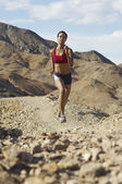 Woman Jogging In Mountains — Stock Photo