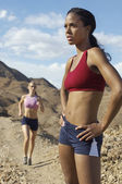 Two Female Joggers In Mountains — Stock Photo