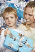 Beautiful Woman With Son Holding Christmas Present — Foto Stock