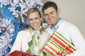 Couple Standing Together With Christmas Gifts — Photo