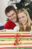 Happy Caucasian Couple With Gift Box — Stock Photo