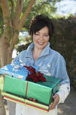 Happy Woman Holding Presents — Stock Photo