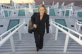 Businesswoman Walking Up Stairs — Stock Photo
