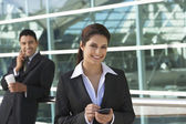 Businesswoman Using PDA Outside Office — Stock Photo
