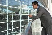 Thoughtful Businessman Leaning On Railing — Stock Photo