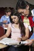 Teacher Assisting Female Student — Stock Photo