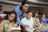Teacher Pointing In Book While Student Looking — Stock Photo