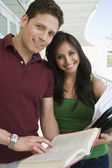 College Students With Book — Stock Photo