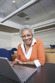 Senior Teacher Using Laptop At Desk — Stock Photo