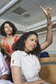 Female Student Raising Hand In Class — Stock Photo