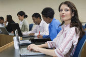 Businesswoman Working On Laptop With Colleagues At Office — Stock Photo