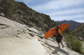 Female Kayaker Walking On Rock — Stock Photo
