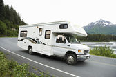 USA, Alaska, Recreational Vehicle Driving On Road — Zdjęcie stockowe