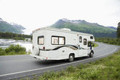 USA, Alaska, Recreational Vehicle Driving On Road — Stock Photo