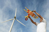 Man Holding Airplane Kite At Wind Farm — Stock Photo