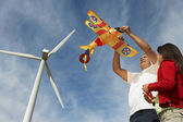 Father Holding Airplane Kite With Daughter — Stock Photo