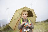 Boy With Umbrella At Wind Farm — Stock Photo