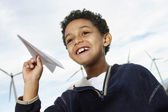 Boy Playing With Paper Plane At Wind Farm — Stock Photo