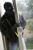 Burglar Breaking Into House — Stock Photo