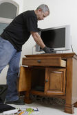 Burglar Stealing Television — Stock Photo