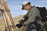 Soldier Cutting Barbed Wire Fence — Foto Stock