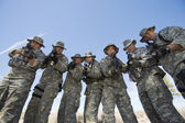 Group Portrait Of Soldiers Aiming Guns — Stock Photo