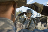 Soldiers saluting — Stock Photo