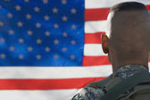 US Army Soldier Looking At Flag — Stock Photo
