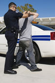 Officer Arresting Young Man — Stock Photo