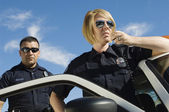 Police Officers Using Two-Way Radio — Stock Photo